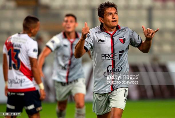 Luis Rodriguez of Argentina's Colon de Santa Fe celebrates after scoring against Peru's Deportivo Municipal during their Copa Sudamericana football...