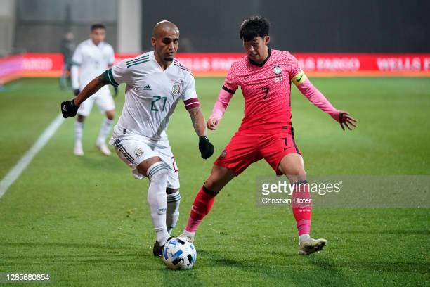 Luis Rodriguez of Mexico and Heungmin Son of South Korea battle for the ball during the international friendly match between Mexico and South Korea...