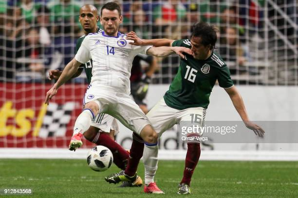 Luis Rodriguez of Mexico fights for the ball with Ognjen Todorovic of Bosnia during the friendly match between Mexico and Bosnia and Herzegovina at...