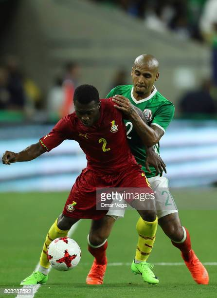 Luis Rodriguez of Mexico fights for the ball with Thomas Agyepong of Ghana during the friendly match between Mexico and Ghana at NRG Stadium on June...