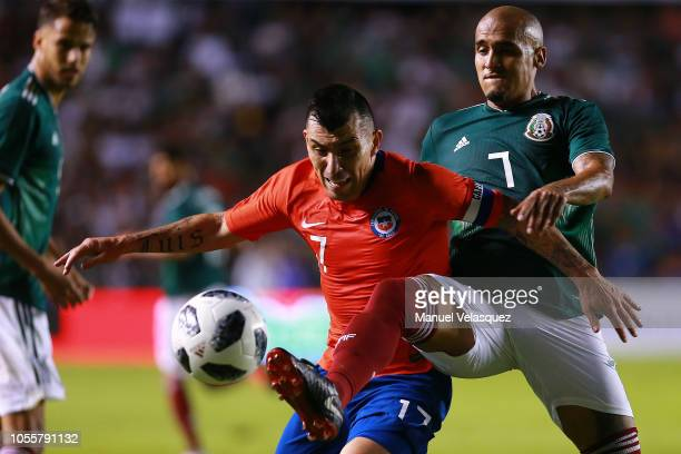 Luis Rodriguez of Mexico struggle for the ball against Gary Medel of Chile during the international friendly match between Mexico and Chile at La...