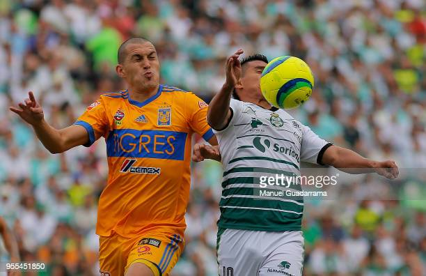 Luis Rodriguez of Tigres and Osvaldo Martinez of Santos fight for the ball during the quarter finals second leg match between Santos Laguna and...
