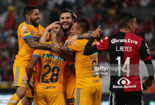 Luis Rodriguez of Tigres celebrates with tetammates after scoring his tema's first goal during the 8nd round match between Atlas and Tijuana as part...