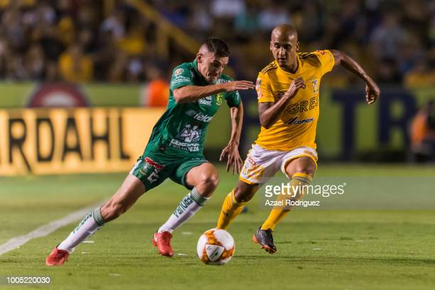 dd8e6ae7c69 Luis Rodriguez of Tigres fights for the ball with Maximiliano Cerato of Leon  during the 1st