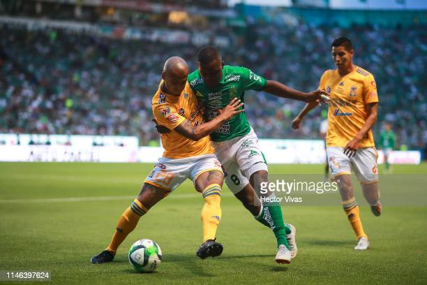 Luis Rodriguez of Tigres struggles for the ball with Joel Campbell of Leon during the final second leg match between Leon and Tigres UANL as part of...
