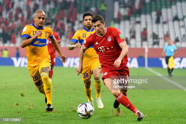 Luis Rodriguez of Tigres UANL, Javier Aquino of Tigres UANL and Robert Lewandowski of Bayern Muenchen battle for the ball during the finale FIFA Club...