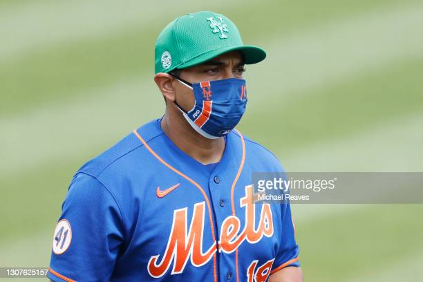Luis Rojas of the New York Mets looks on against the Miami Marlins prior to a Grapefruit League spring training game at Roger Dean Stadium on March...