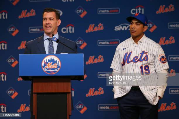 Luis Rojas right listens in as New York Mets General Manager Brodie Van Wagenen talks after being introduced as the team's new manager at Citi Field...