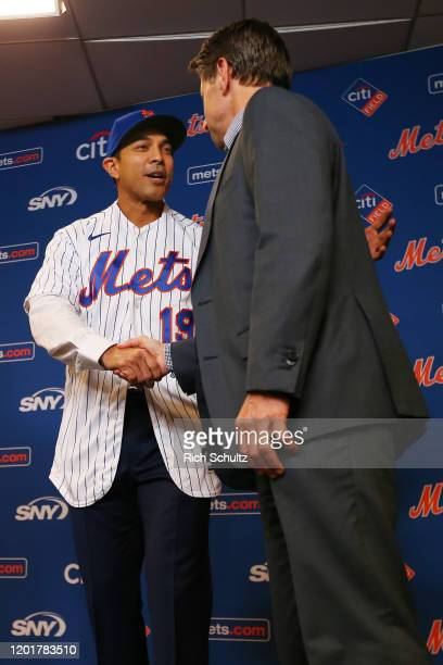 Luis Rojas shakes hands with New York Mets Chief Operating Officer Jeff Wilpon as he is introduced as the team's new manager during a press...