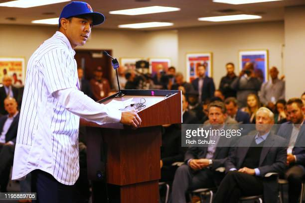 Luis Rojas speaks after being introduced as the new manager of the New York Mets at Citi Field on January 24 2020 in New York City Looking on in the...