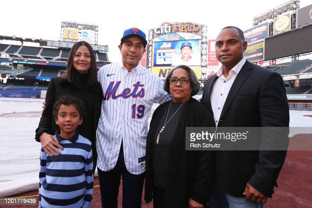 Luis Rojas the new manager of the New York Mets poses with his wife Laura son Luis Felipe mother Elsa Brens and brother Felipe Alou Jr after his...