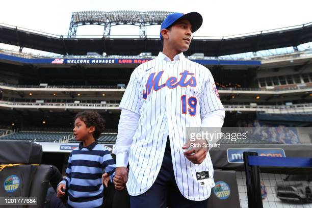 Luis Rojas the new manager of the New York Mets walks onto the field with his son Luis Felipe after his introductory press conference at Citi Field...