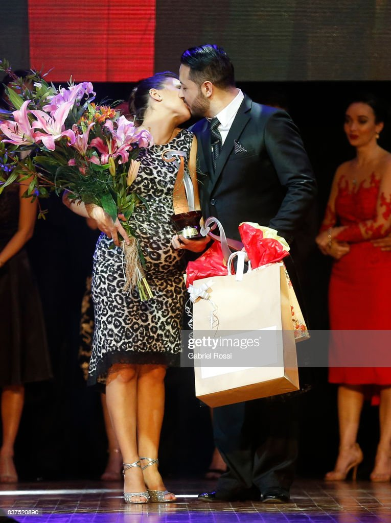 Luis Romero and Ana Migoni of Argentina celebrate after winning the third place during the final round of the Tango Salon competition as part of the Buenos Aires International Tango Festival and Championship 2017 at Luna Park on August 22, 2017 in Buenos Aires, Argentina.