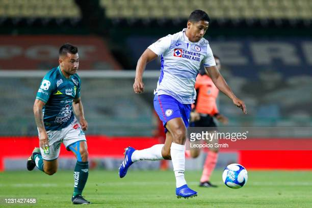 Luis Romo of Cruz Azul competes for the ball with Jean Meneses of Leon during the 8th round match between Leon and Cruz Azul as part of the Torneo...