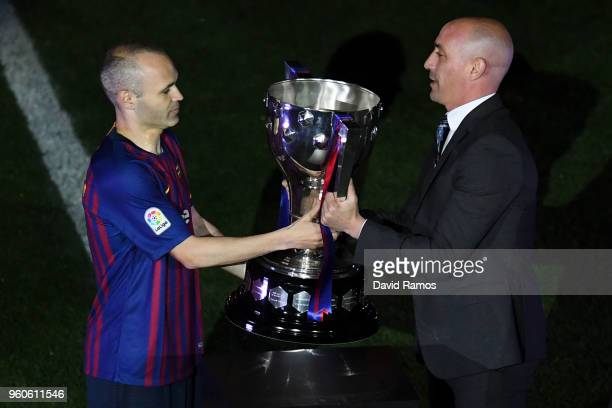 Luis Rubiales President of the Spanish Football Federation gives the La Liga trophy to Andres Iniesta of FC Barcelona at the end of the La Liga match...
