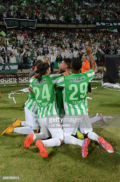Luis Ruiz of Atletico Nacional celebrates with teammates after scoring the first goal of his team during a first leg semifinal match between Atletico...