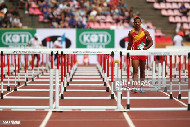 Luis Salort of Spain walks down the track after failing to finish during heat 3 of the men's 110m hurdles semi final on day two of The IAAF World U20...