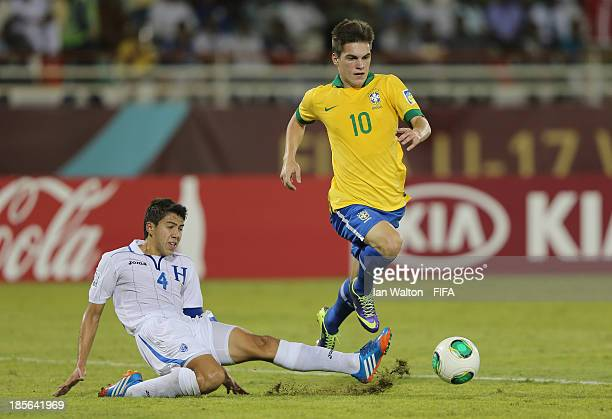 Luis Santos of Honduras tries to tackle Nathan of Brazil during the Group A FIFA U17 World Cup match between Honduras and Brazil at Ras Al Khaimah...