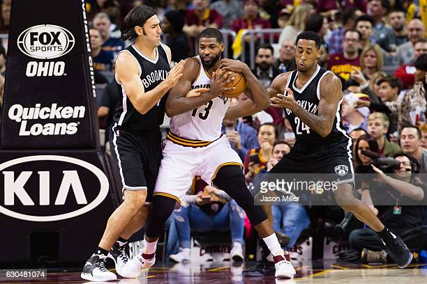 Luis Scola and Rondae HollisJefferson of the Brooklyn Nets guard Tristan Thompson of the Cleveland Cavaliers during the second half at Quicken Loans...