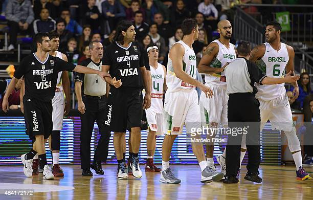 Luis Scola of Argentina and Augusto Cesar de Lima of Brazil discuss during a match between Argentina and Brazil as part of Four Nations Championship...