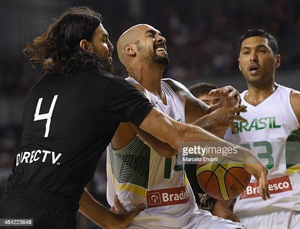 Luis Scola of Argentina and Marcus Vinicius Vieira of Brazil fight fot the ball during a match between Argentina and Brazil as part of Four Nations...