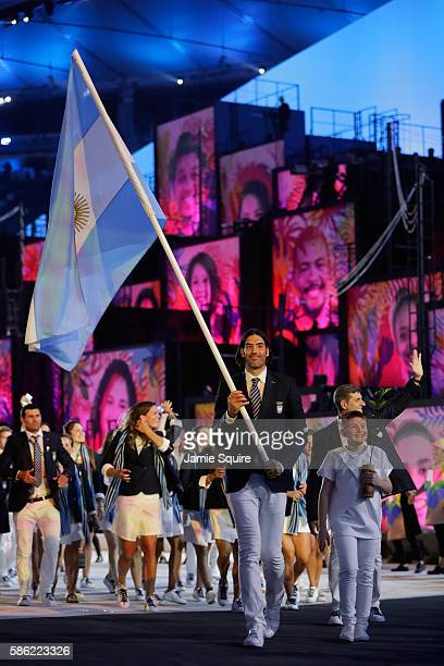 Luis Scola of Argentina carries his country's flag during the Opening Ceremony of the Rio 2016 Olympic Games at Maracana Stadium on August 5 2016 in...