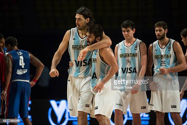 Luis Scola of Argentina celebrates with Facundo Campazzo after winning a second stage match between Argentina and Dominican Republic as part of the...
