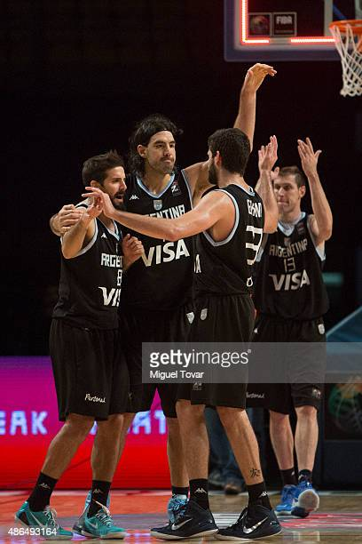 Luis Scola of Argentina celebrates with teammates after winning a match between Venezuela and Argentina as part of the 2015 FIBA Americas...