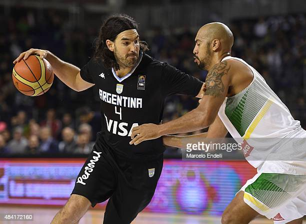 Luis Scola of Argentina drives against Marcus Vinicius of Brazil during a match between Argentina and Brazil as part of Four Nations Championship at...