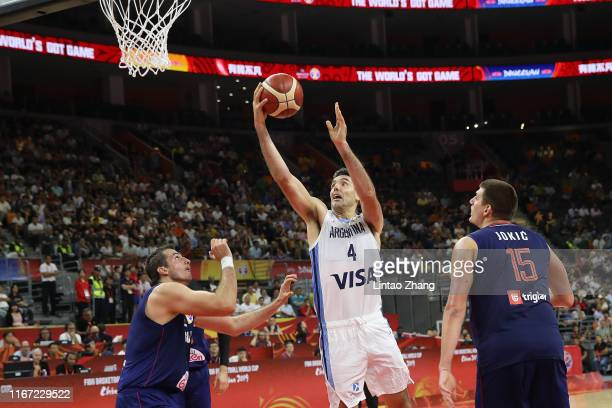 Luis Scola of Argentina drives to basket against Nemanja Bjelica of Serbia during FIBA World Cup 2019 Quarter-finals match between Argentina and...