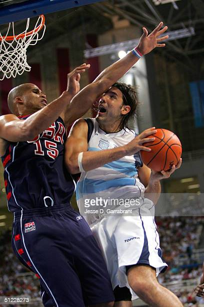 Luis Scola of Argentina goes to the basket against Richard Jefferson of the USA during the mens' basketball semifinal game on August 27 2004 during...