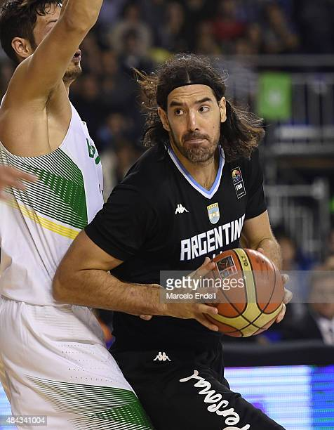 Luis Scola of Argentina handles the ball during a match between Argentina and Brazil as part of Four Nations Championship at Tecnopolis Stadium on...