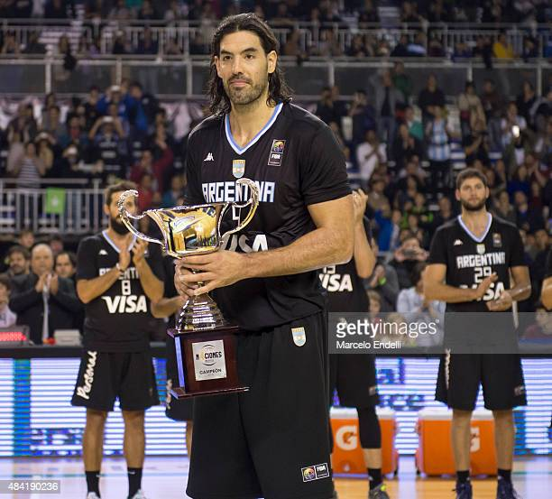 Luis Scola of Argentina holds the trophy after a match between Argentina and Brazil as part of Four Nations Championship at Tecnopolis Stadium on...