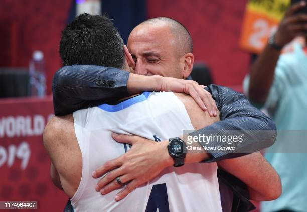 Luis Scola of Argentina hugs with Emanuel Ginóbili after FIBA World Cup 2019 semi-final match against France at Wukesong Sport Arena on September 13,...