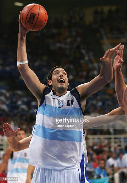 Luis Scola of Argentina shoots over the defenseof Italy during the men's basketball gold medal contest game on August 28, 2004 during the Athens 2004...