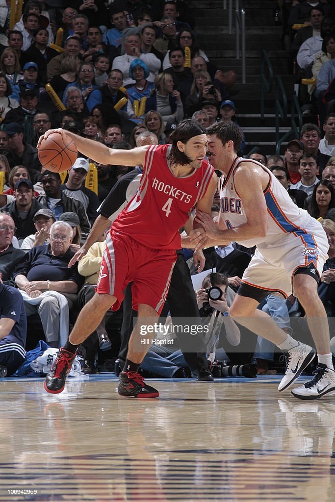 Luis Scola #4 of the Houston Rockets drives against Nick Collison #4 of the Oklahoma City Thunder on November 17, 2010 at the Oklahoma City Arena in Oklahoma City, Oklahoma.