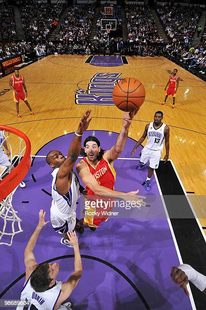 Luis Scola of the Houston Rockets hooks a shot over Carl Landry of the Sacramento Kings at Arco Arena on April 12 2010 in Sacramento California The...