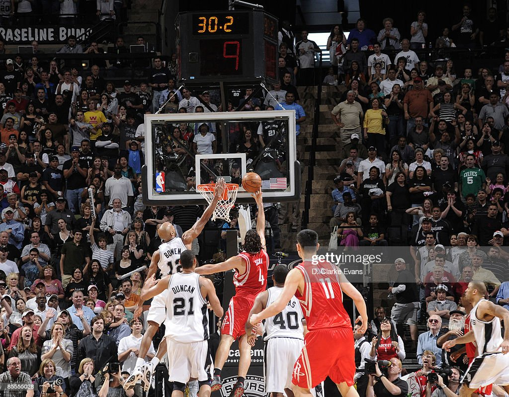 Luis Scola #4 of the Houston Rockets makes the winning shot against the San Antonio Spurs on March 22, 2009 at the AT&T Center in San Antonio, Texas.