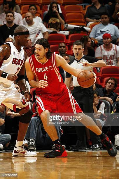 Luis Scola of the Houston Rockets posts up against Jermaine O'Neal of the Miami Heat during the game at American Airlines Arena on February 9 2010 in...