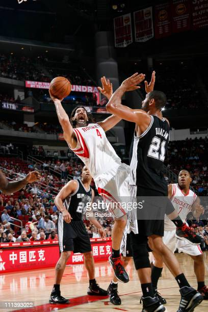 Luis Scola of the Houston Rockets shoots the ball over Tim Duncan of the San Antonio Spurs on April 1 2011 at the Toyota Center in Houston Texas NOTE...
