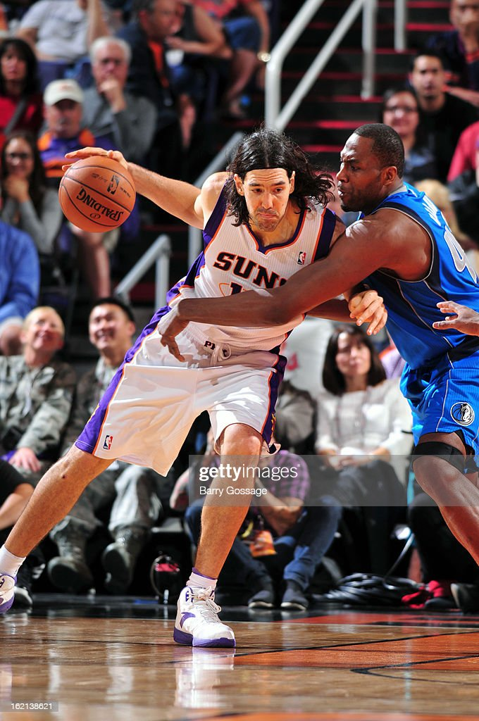 Luis Scola #14 of the Phoenix Suns drives to the basket against the Dallas Mavericks on February 1, 2013 at U.S. Airways Center in Phoenix, Arizona.