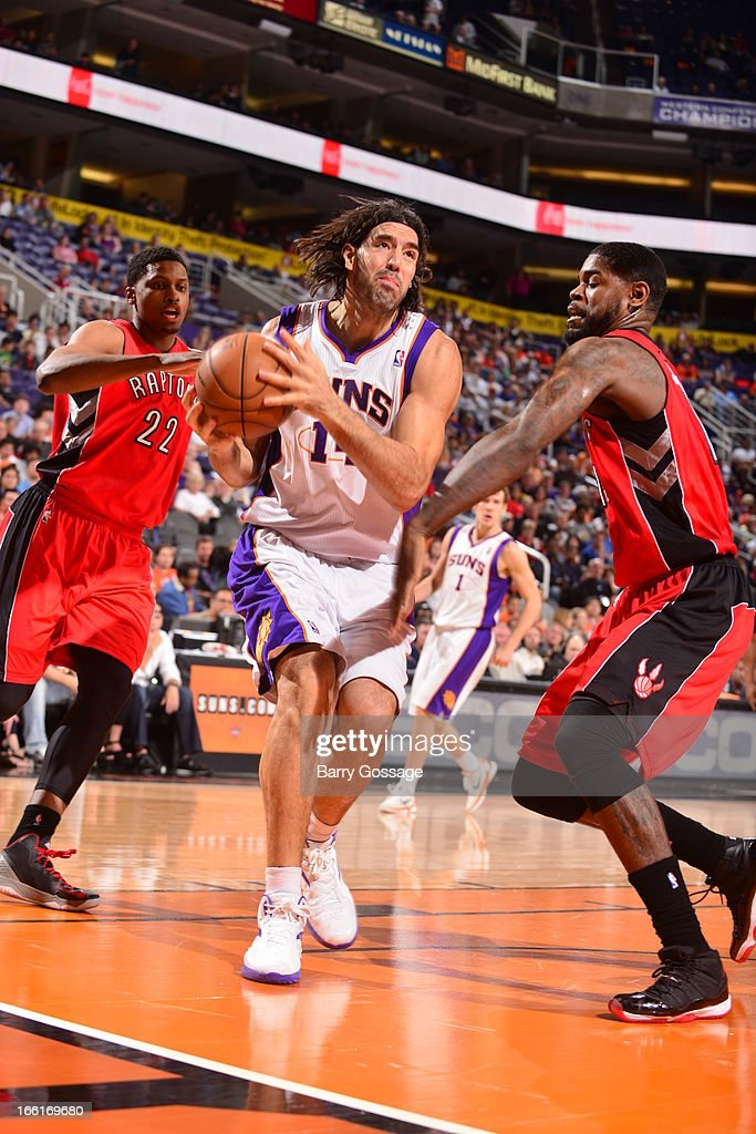 Luis Scola #14 of the Phoenix Suns drives to the basket against the Toronto Raptors on March 6, 2013 at U.S. Airways Center in Phoenix, Arizona.