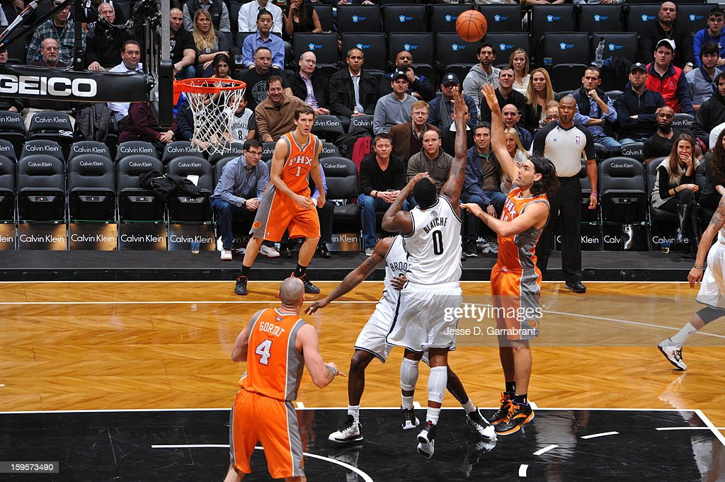 Luis Scola #14 of the Phoenix Suns puts up a shot against the Brooklyn Nets at the Barclays Center on January 11, 2013 in Brooklyn, New York.