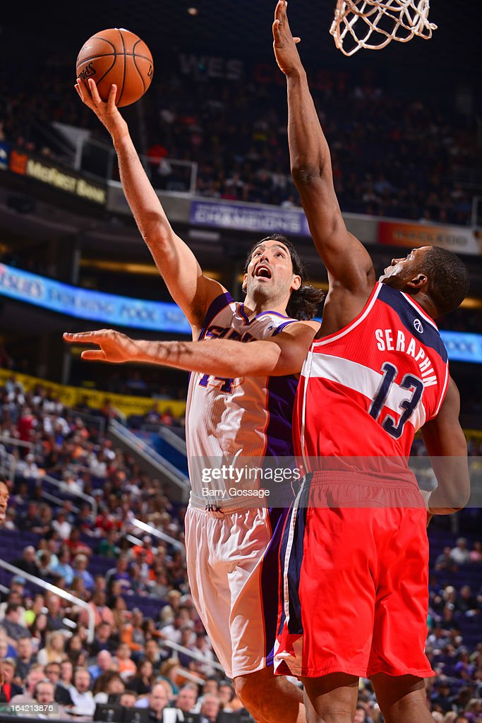 Luis Scola #14 of the Phoenix Suns shoots a layup against Kevin Seraphin #13 of the Washington Wizards on March 20, 2013 at U.S. Airways Center in Phoenix, Arizona.