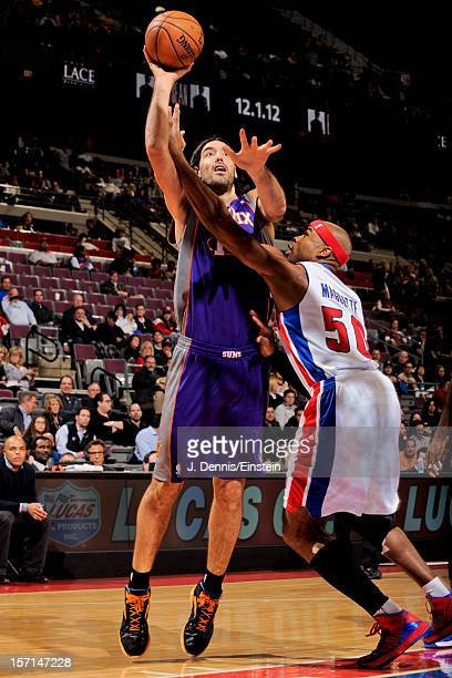 Luis Scola of the Phoenix Suns shoots against Corey Maggette of the Detroit Pistons on November 28 2012 at The Palace of Auburn Hills in Auburn Hills...