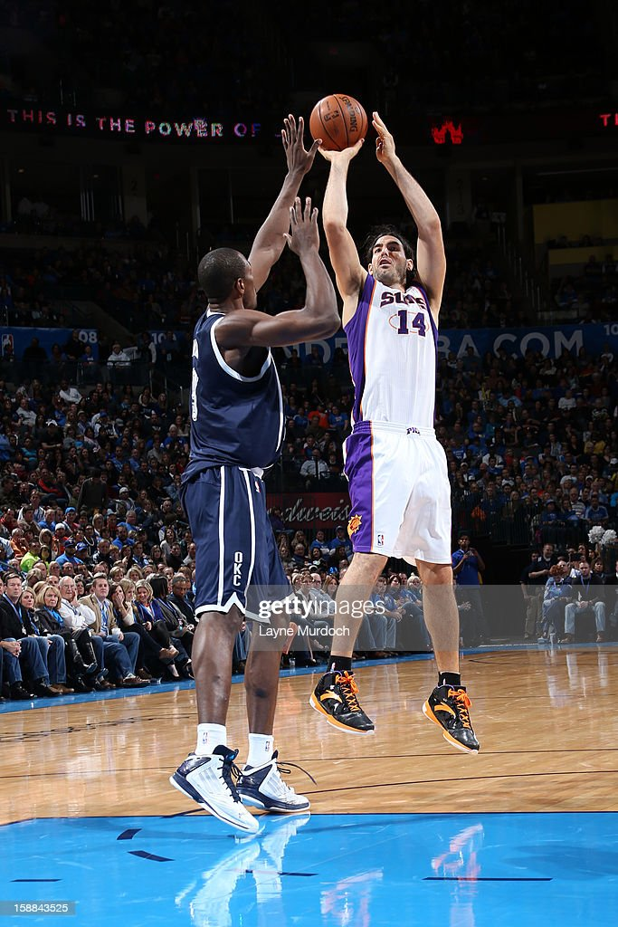 Luis Scola #14 of the Phoenix Suns shoots over the Oklahoma City Thunder during an NBA game on December 31, 2012 at the Chesapeake Energy Arena in Oklahoma City, Oklahoma.