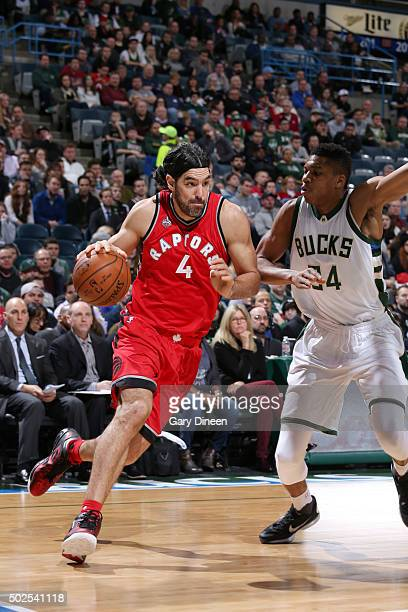 Luis Scola of the Toronto Raptors drives to the basket against the Milwaukee Bucks during the game on December 26 2015 at BMO Harris Bradley Center...