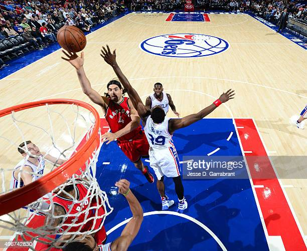 Luis Scola of the Toronto Raptors goes up for the layup against the Philadelphia 76ers at Wells Fargo Center on November 11 2015 in Philadelphia...