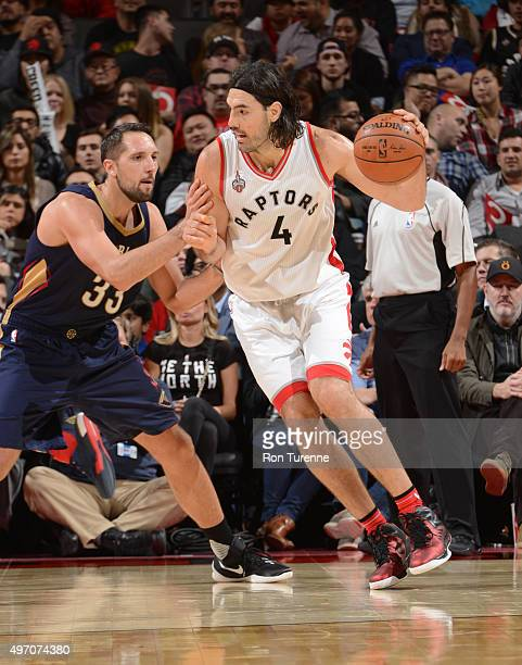 Luis Scola of the Toronto Raptors handles the ball against Ryan Anderson of the New Orleans Pelicans on November 13 2015 at the Air Canada Centre in...