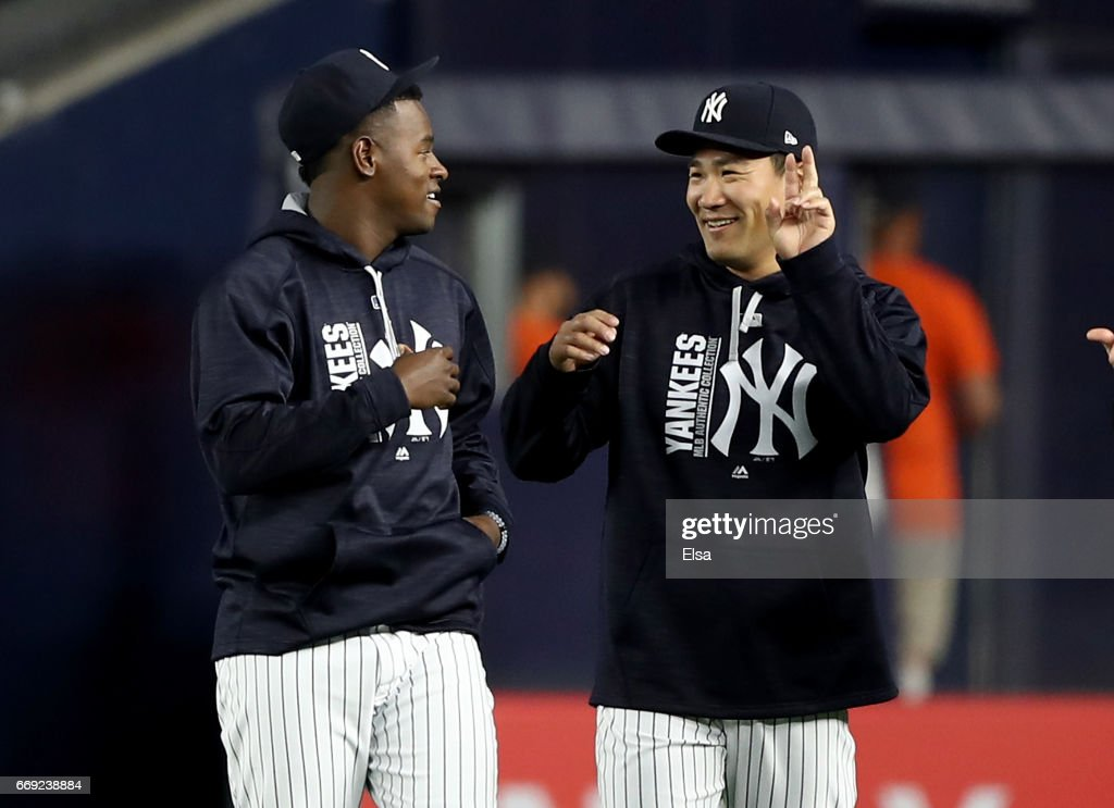 Luis Severino #40 and Masahiro Tanaka #19 of the New York Yankees walk in from the bullpen before the game against the St. Louis Cardinals on April 16, 2017 at Yankee Stadium in the Bronx borough of New York City.